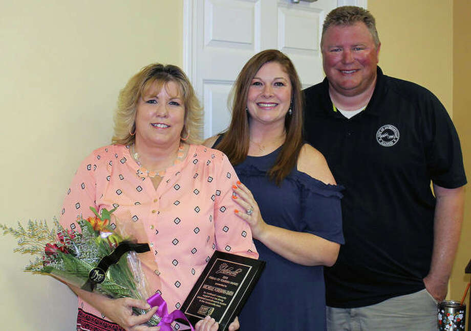 Michelle Foreman-Smith (left), general manager of Hampton Inn by Hilton, was presented the Jacksonville Area Convention & Visitors Bureau's Friend of Tourism award by bureau director Brittany Henry and Mayor Andy Ezard.