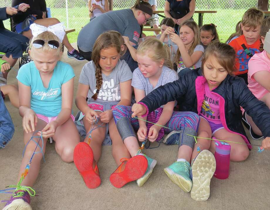 Third graders make their lanyards during Illinois Day at Township Park.