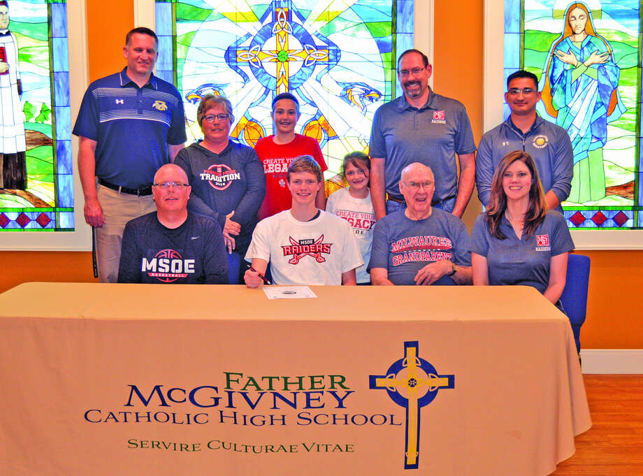 Father McGivney senior Logan Shumate will play basketball at Milwaukee School of Engineering. In the front row, from left to right, are father Jeff Shumate, Logan Shumate, grandfather Jim Halvachs and mother Michelle Travnicek. In the back row, from left to right, are FMCHS coach Rich Beyers, stepmother Cindy Shumate, sister Emilee Travnicek, sister Alexis Travnicek, stepfather Chad Travnicek and FMCHS athletic director Jeff Oller.