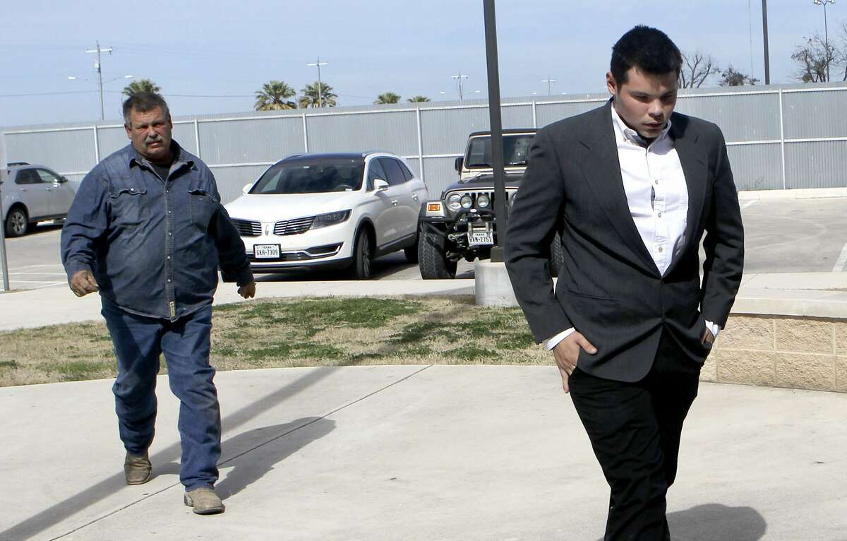 Jack Young (right) heads into the Uvalde County Justice Center Wednesday January 31, 2018. Young was involved in a crash last year that killed 13 members of a New Braunfels church. Young was appearing in Uvalde for a hearing that was reset for May 31, 2018.