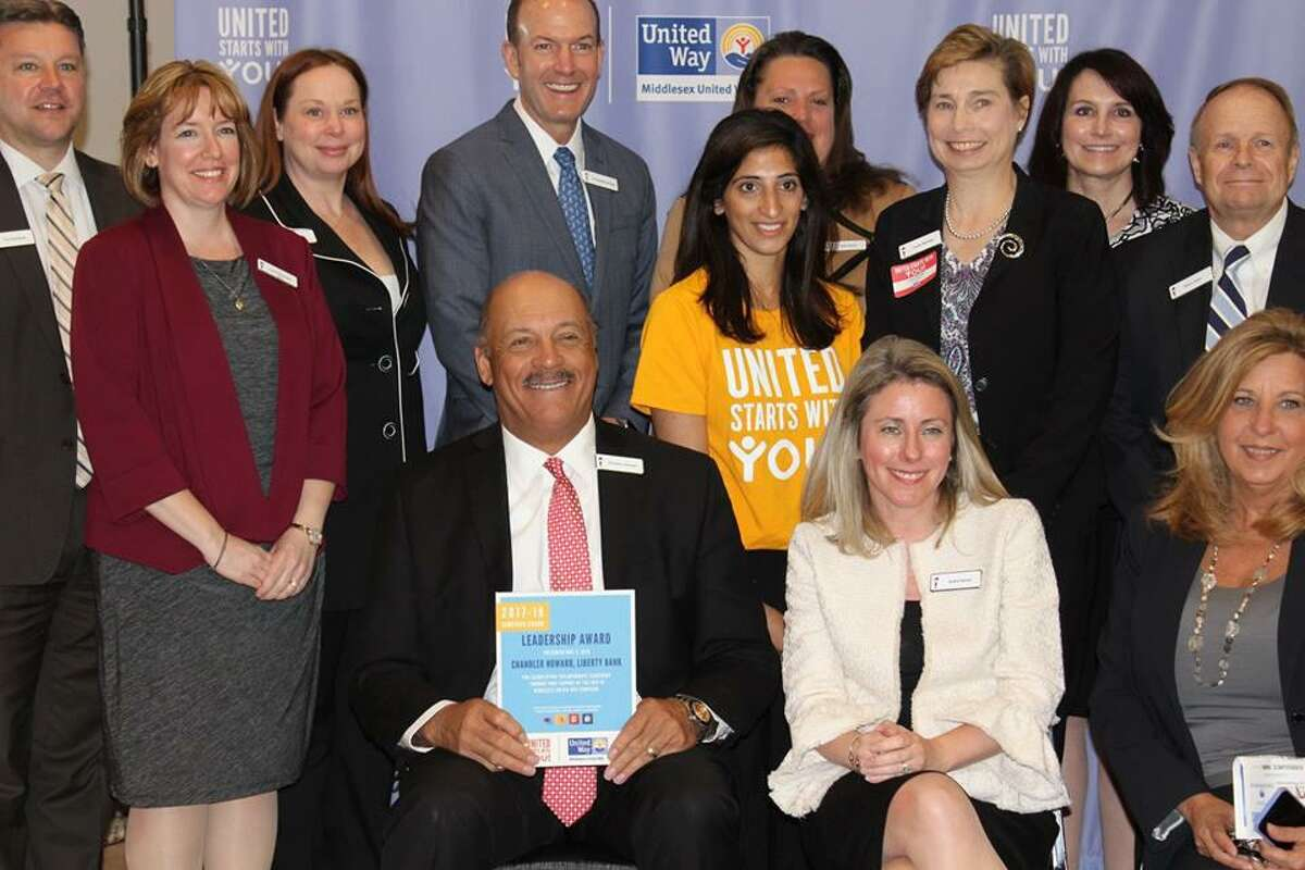 Chandler Howard of Liberty Bank poses with his team during the United Way Campaign Awards Breakfast on Tuesday.