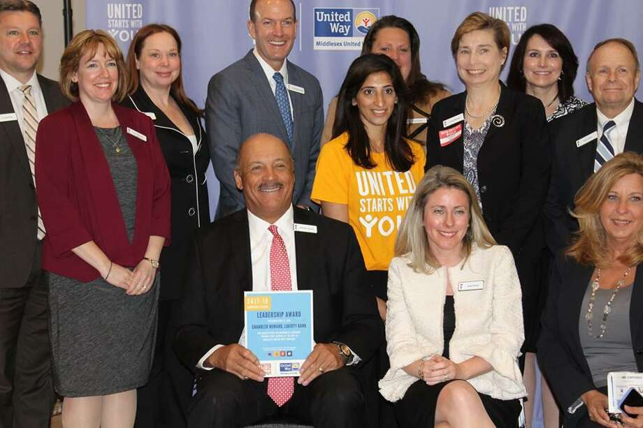 Chandler Howard of Liberty Bank poses with his team during the United Way Campaign Awards Breakfast on Tuesday. Photo: Courtesy Of Middlesex United Way