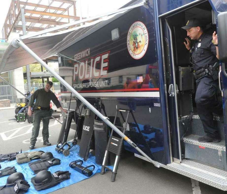 Police officers display tactile gear at an open-house event. Photo: Photo: / Hearst Media / Bob Luckey