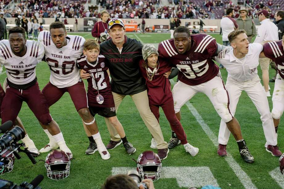 Jimbo Fisher's son Ethan (camouflage hat) joins his dad on the field. Photo: Courtesy Photo / Thomas Campbell
