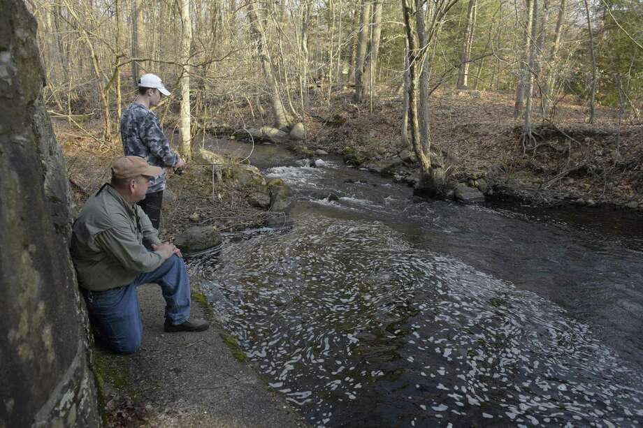 File photo of anglers fishing near the West Redding train station on opening day of trout fishing season in Connecticut, Saturday, April 14, 2018, in Redding, Conn. Photo: H John Voorhees III / Hearst Connecticut Media / The News-Times