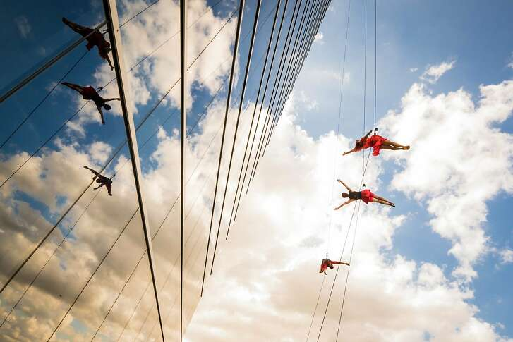 Watch open rehearsals by the aerial-dance company BANDALOOP (shown flying high in Dallas). Photo: James Adamson.