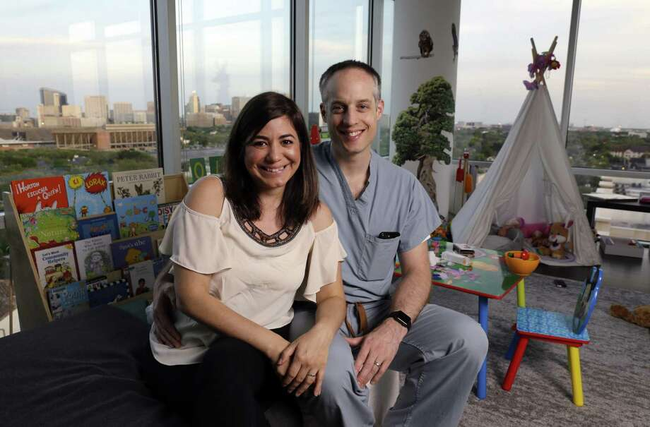 Rivka Colen and Pascal Zinn in the toy strewn living room of their 11th floor apartment overlooking Rice University and the medical center. Pascal and Rivka rescued some 16 neighbors from their flooded homes on Braesvalley, where they lived when Hurricane Harvey hit last year. Photo: Michael Wyke,  Freelance / For The Chronicle / © 2018 Houston Chronicle