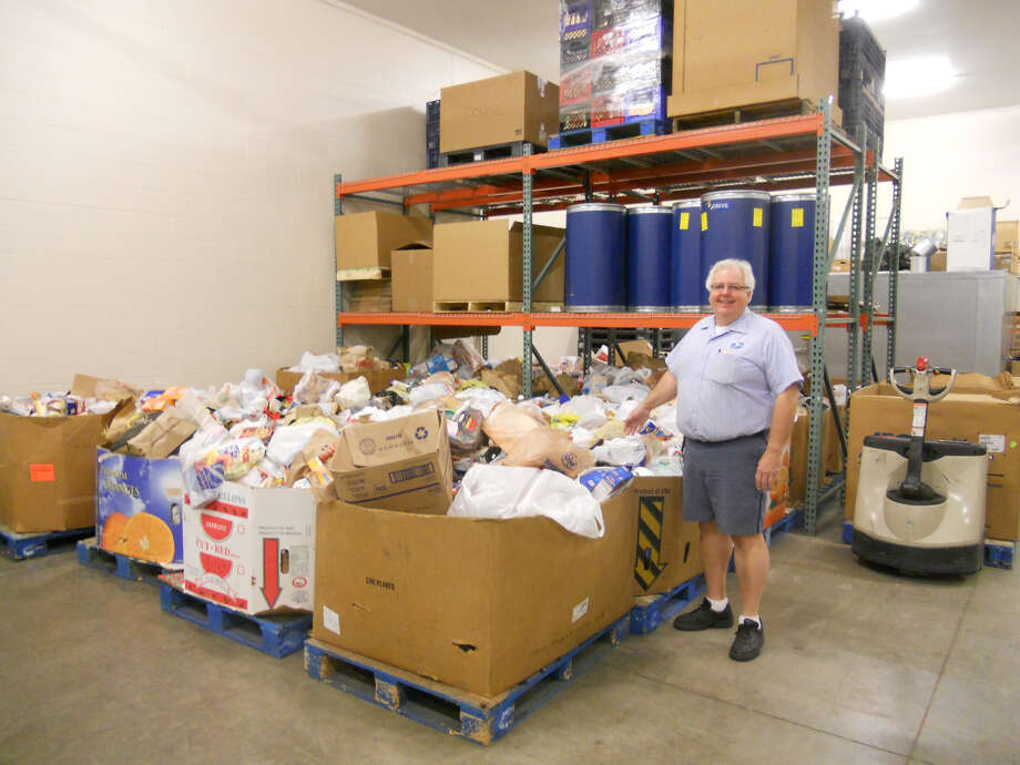 A volunteer with Hidden Harvest processes food donations. (Photo provided)