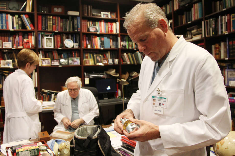 "Dr. Billy Cohn holds an artificial heart while while visiting the office of Dr. O.H. ""Bud"" Frazier at St. Luke's Episcopal Hospital Jan. 9, 2013. Photo: Mayra Beltran"