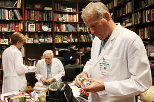 """Dr. Billy Cohn holds an artificial heart while while visiting the office of Dr. O.H. """"Bud"""" Frazier at St. Luke's Episcopal Hospital Jan. 9, 2013."""