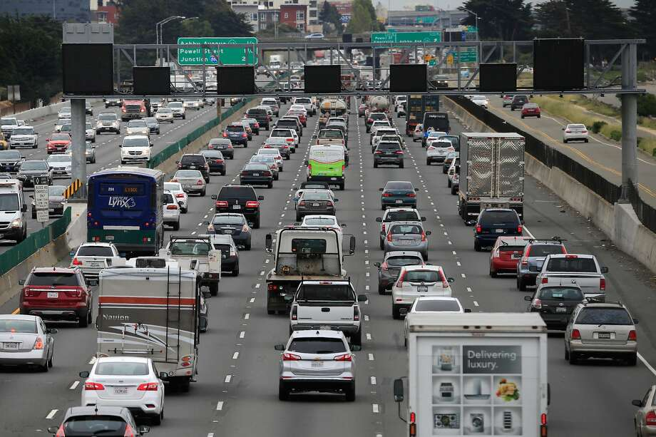 Motorists drive in Berkeley last month. The car industry wants to relax fuel economy standards, but not so much that they provoke a fight with California. Photo: Michael Macor / The Chronicle