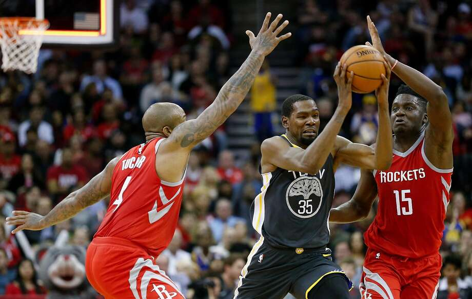 HOUSTON, TX - JANUARY 20:  Kevin Durant #35 of the Golden State Warriors attempts to get the shot off before the half as Clint Capela #15 of the Houston Rockets and PJ Tucker #4 defend at Toyota Center on January 20, 2018 in Houston, Texas. NOTE TO USER: User expressly acknowledges and agrees that, by downloading and or using this photograph, User is consenting to the terms and conditions of the Getty Images License Agreement.  (Photo by Bob Levey/Getty Images) Photo: Bob Levey / Getty Images