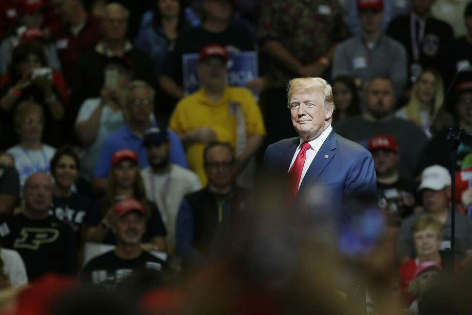 President Trump's policies remain popular with many Americans, which means Democrats need to find a campaign strategy beyond just bashing him. Photo: Joshua Lott / Bloomberg