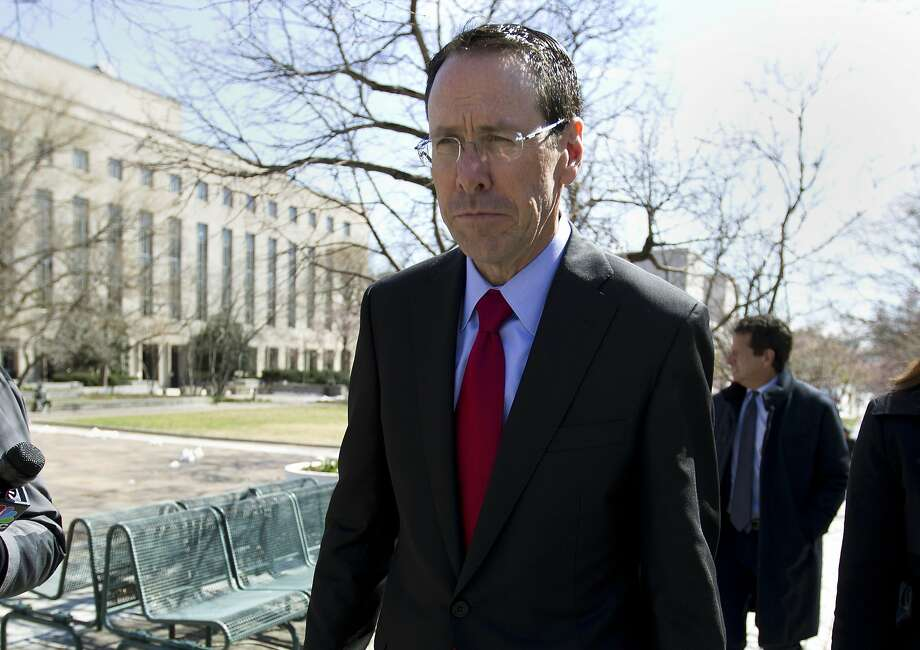 "FILE - In this March 22, 2018 file photo, AT&T CEO Randall Stephenson leaves the federal courthouse in Washington.  Stephenson says the company made a ""big mistake"" in hiring President Donald Trump's attorney Michael Cohen as a political consultant.  In an internal memo to employees, obtained by The Associated Press, Friday, May 11, Stephenson called the hiring a ""serious misjudgment,'"" and said that the company's chief lobbyist in Washington is leaving.   (AP Photo/Jose Luis Magana) Photo: Jose Luis Magana, Associated Press"