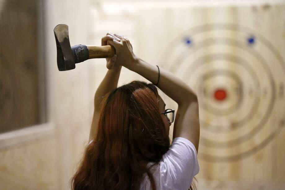 Lucy Barbosa learns how to throw an axe, Thursday May 10, 2018, at San Antonio Axe Throwing Class Axe. Photo: Edward A. Ornelas, Staff / San Antonio Express-News / © 2018 San Antonio Express-News