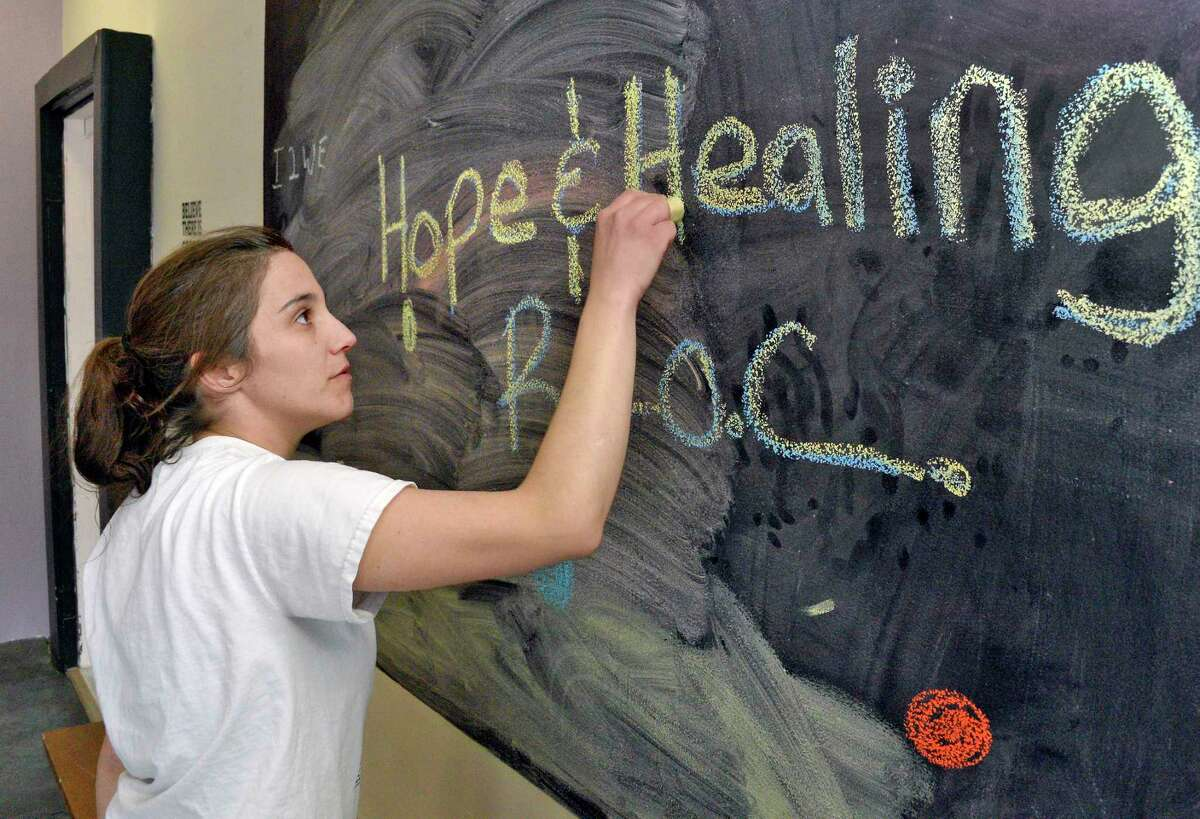 Co-chair of the Friends of Recovery Warren and Washington counties, Ashley Livingston in the community room at the Hope & Healing Recovery Community Center Tuesday April 10, 2018 in Hudson Falls, NY. (John Carl D'Annibale/Times Union)
