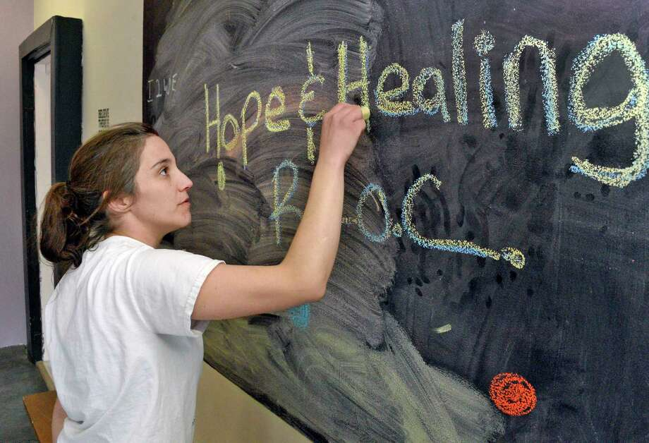 Co-chair of the Friends of Recovery Warren and Washington counties, Ashley Livingston in the community room at the Hope & Healing Recovery Community Center Tuesday April 10, 2018 in Hudson Falls, NY.  (John Carl D'Annibale/Times Union) Photo: John Carl D'Annibale / 20043459A