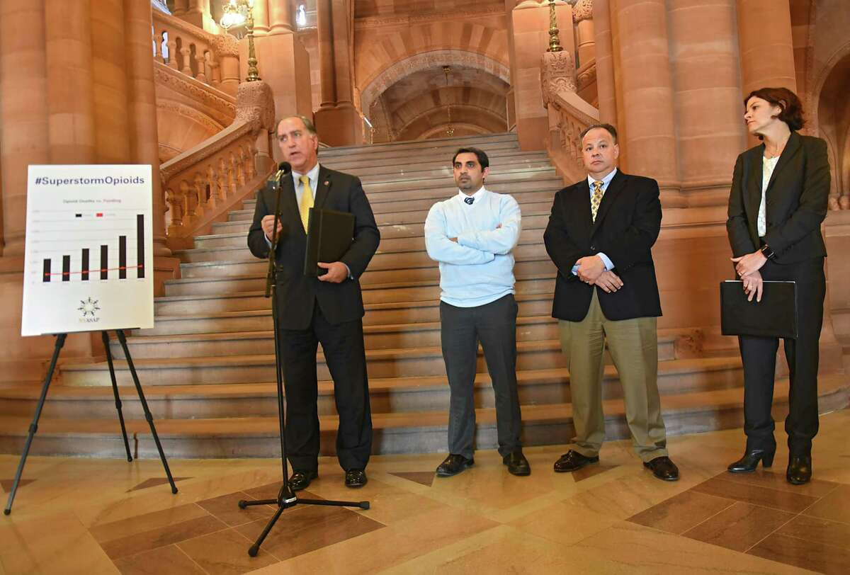 New York Association of Alcoholism And Substance Abuse Providers (ASAP) Executive Director John Coppola, left, launches the ÔSuperstorm OpioidsO advocacy campaign in the New York State Capitol on Tuesday, Dec. 19, 2017 in Albany, N.Y. Also with him from left are, cardiologist Mustafain Meghani, Kevin Connally, executive director of Hope House, and Stephanie Campbell, executive director of Friends of Recovery New York. (Lori Van Buren / Times Union)