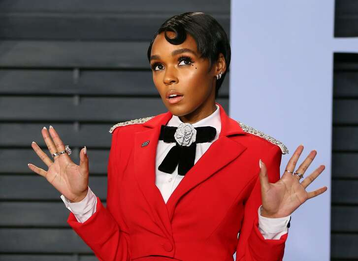 """(FILES) In this file photo taken on March 4, 2018 Janelle Monae attends the 2018 Vanity Fair Oscar Party following the 90th Academy Awards at The Wallis Annenberg Center for the Performing Arts in Beverly Hills, California, on March 04, 2018.  The singer Janelle Monae on April 20, 2018 announced the release of a dystopian film to accompany her first album in nearly five years, which was initially being produced by Prince. Monae, who has increasingly focused on acting of late with roles in the Oscar-winning film """"Moonlight"""" and the well-received NASA history pic """"Hidden Figures,"""" will roll out """"Dirty Computer"""" on April 27. The 44-minute film, """"Dirty Computer: an Emotion Picture by Janelle Monae,"""" will come out a day earlier and bring together music videos tied to the album, the singer said.  / AFP PHOTO / JEAN-BAPTISTE LACROIXJEAN-BAPTISTE LACROIX/AFP/Getty Images"""