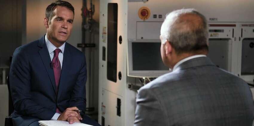 Bloomberg TV reporter Erik Schatzker, left, interviews GlobalFoundries CEO Tom Caulfield Monday at Fab 8 in Malta.