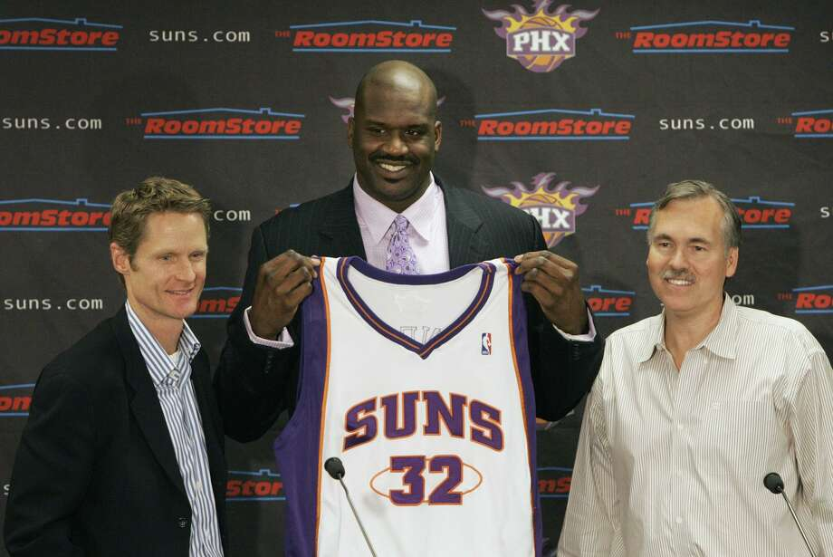 Suns general manager Steve Kerr (left) acquired Shaquille O'Neal in a trade in 2008. The two are shown here with then Suns coach Mike D'Antoni smile. Kerr shared a years old clip of Shaq, right after the Los Angeles Lakers' early 2000s run, saying that no coach would ever take a team to the NBA Finals in four out of five years and promised that he would kiss the feet of who ever did. Problem is, Kerr and the Golden State Warriors have now been to the NBA Finals five years in a row. Photo: Ross D. Franklin / Associated Press 2008 / AP2008