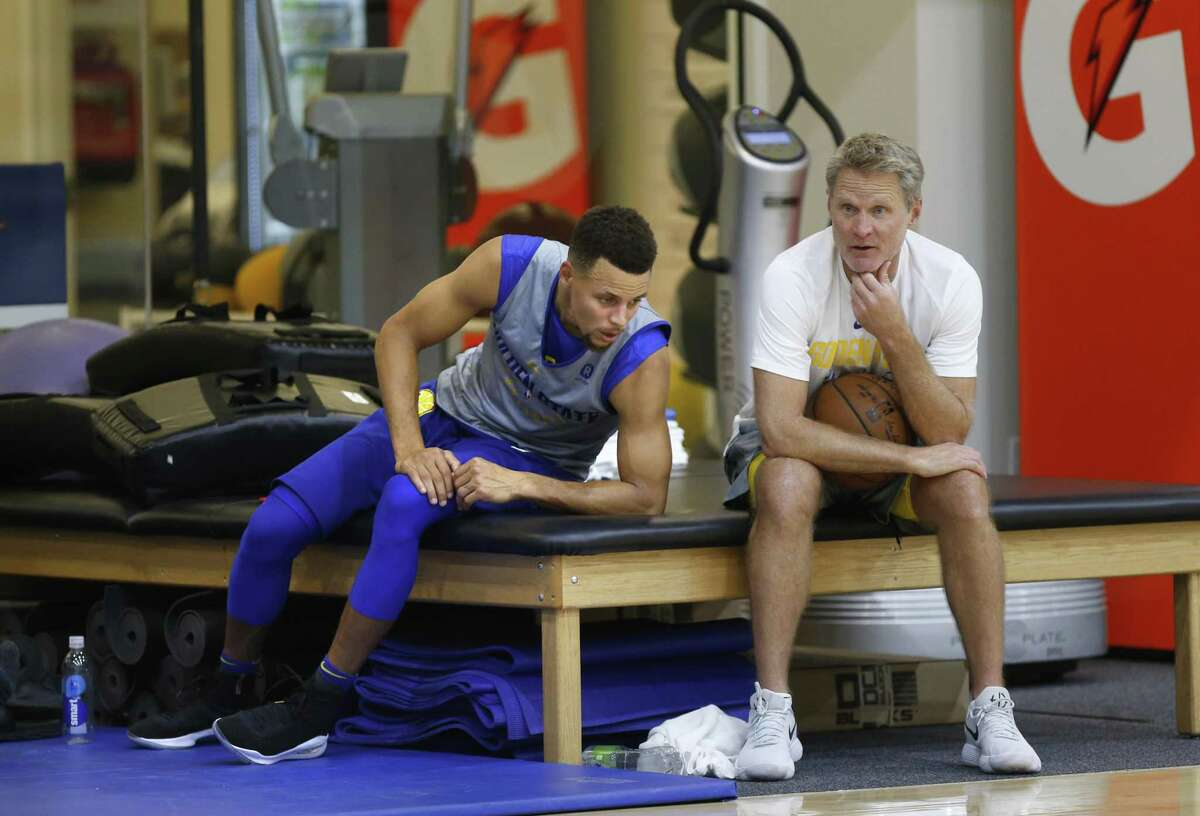 Golden State Warriors' Steph Curry and coach Steve Kerr hanging out near the end of practice at the Warriors practice facility in Oakland, Ca. on Wednesday October 11, 2017.