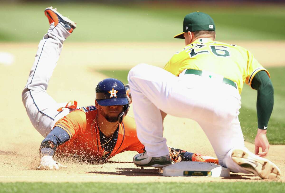 Astros' third baseman Alex Bregman (2) steals second base in a recent game against Oakland. The Astros have 12 stolen bases, and Bregman leads the team with three.