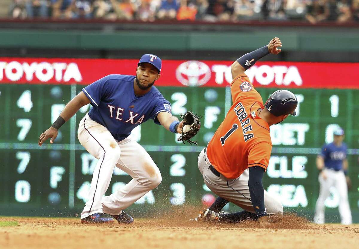 The Astros' Carlos Correa steals second base against Rangers shortstop Elvis Andrus during a game in Arlington last month.
