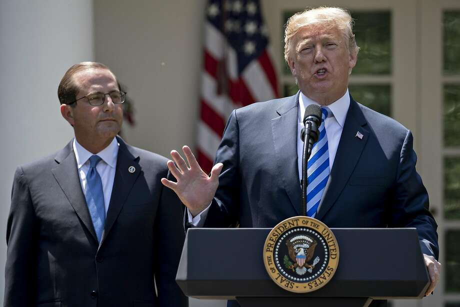 President Trump speaks about cutting drug costs with Health and Human Services Secretary Alex Azar at the White House. Photo: Andrew Harrer / Bloomberg News