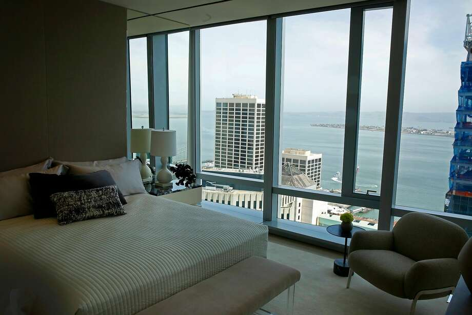 A bedroom in the model home at the 181 Fremont Residences has sweeping views of the bay. Photo: Michael Macor / The Chronicle