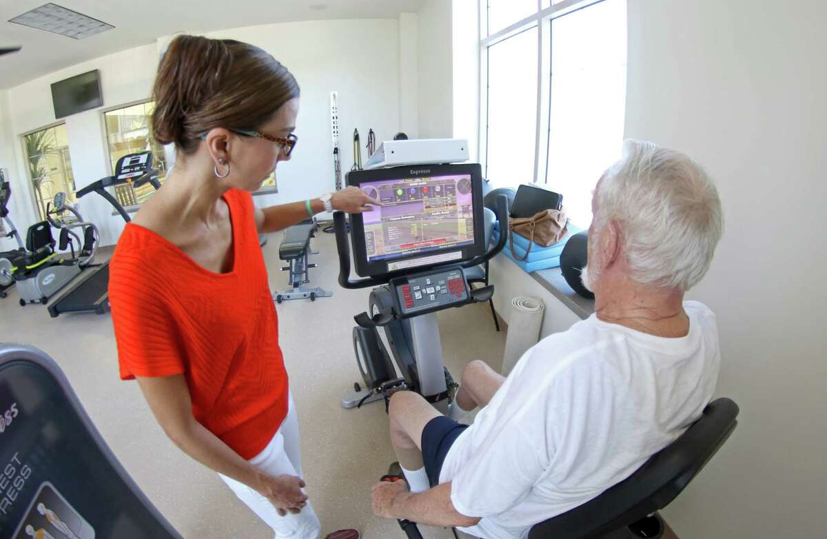 Dr. Nicole Barcelos works with a senior taking part in a study led by Union College which found significant improvement in patients with certain complex thinking and memory skills after exergaming (video games that also require physical exercise). The results could encourage seniors, caregivers and health care providers to pursue or prescribe exergames in hopes of slowing the debilitating effects of those with MCI. (Courtesy Union College)