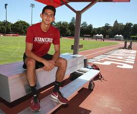Grant Fisher, a Stanford junior, is one of the top distance runners in the nation, as a portrait is taken of him on the track at Stanford University on Wednesday, May 9, 2018 in Palo Alto, Calif.
