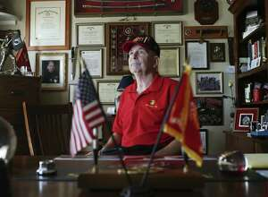 Surrounded by items documenting his military service, David Winnett, 63, of New Braunfels, is a leader in the effort to get the VA to increase benefits for Gulf War veterans who were exposed to toxins. A former Marine captain, he was exposed to nerve gases and other toxic chemicals. He is a paraplegic after surgery related to a service-related back ailment.