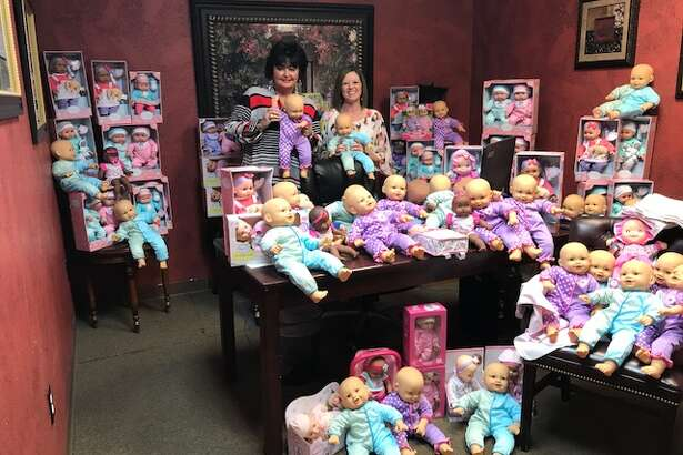 Mary Wright-McCourt, left, and Julie Gray show off the dolls they collected for their project, Angie's Babies. The dolls will be distributed today to women in nursing homes who are Alzheimer's patients.