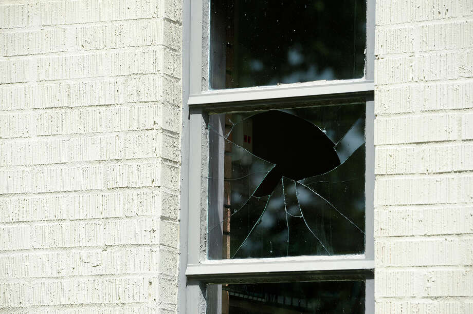 A broken window at St. Stephen's Episcopal Church. A package exploded outside of the church's office sometime on Wednesday night or Thursday morning.  Photo taken Friday 5/11/18 Ryan Pelham/The Enterprise Photo: Ryan Pelham, Ryan Pelham/The Enterprise / ©2018 The Beaumont Enterprise/Ryan Pelham