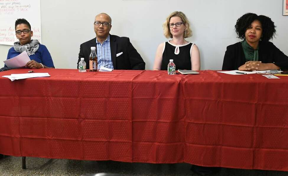 From left, Albany school board candidate Damarise Alexander-Mann, Kenny Bruce, Ellen Roach and Tabetha Wilson at a forum at the Citizen Action office on Tuesday, May 8, 2018 in Albany, N.Y.