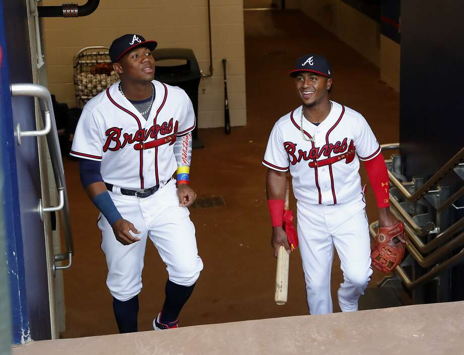 Braves left fielder Ronald Acuna Jr. (left), 20, and second baseman Ozzie Albies, 21, are two of the youngest players in Major League Baseball. Photo: John Bazemore / Associated Press