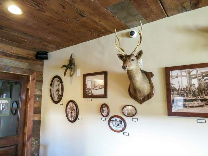 Wall of family photographs at Pinkerton's Barbecue