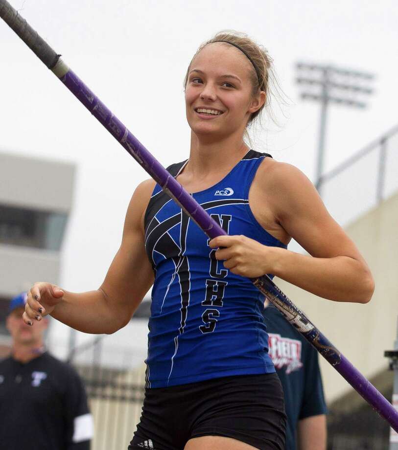 Nastassja Campbell of New Caney laughs while competing in the girls pole vault during the Region III-5A track and field championships at Turner Stadium, Saturday, April 29, 2017, in Humble. Photo: Jason Fochtman, Staff Photographer / © 2017 Houston Chronicle