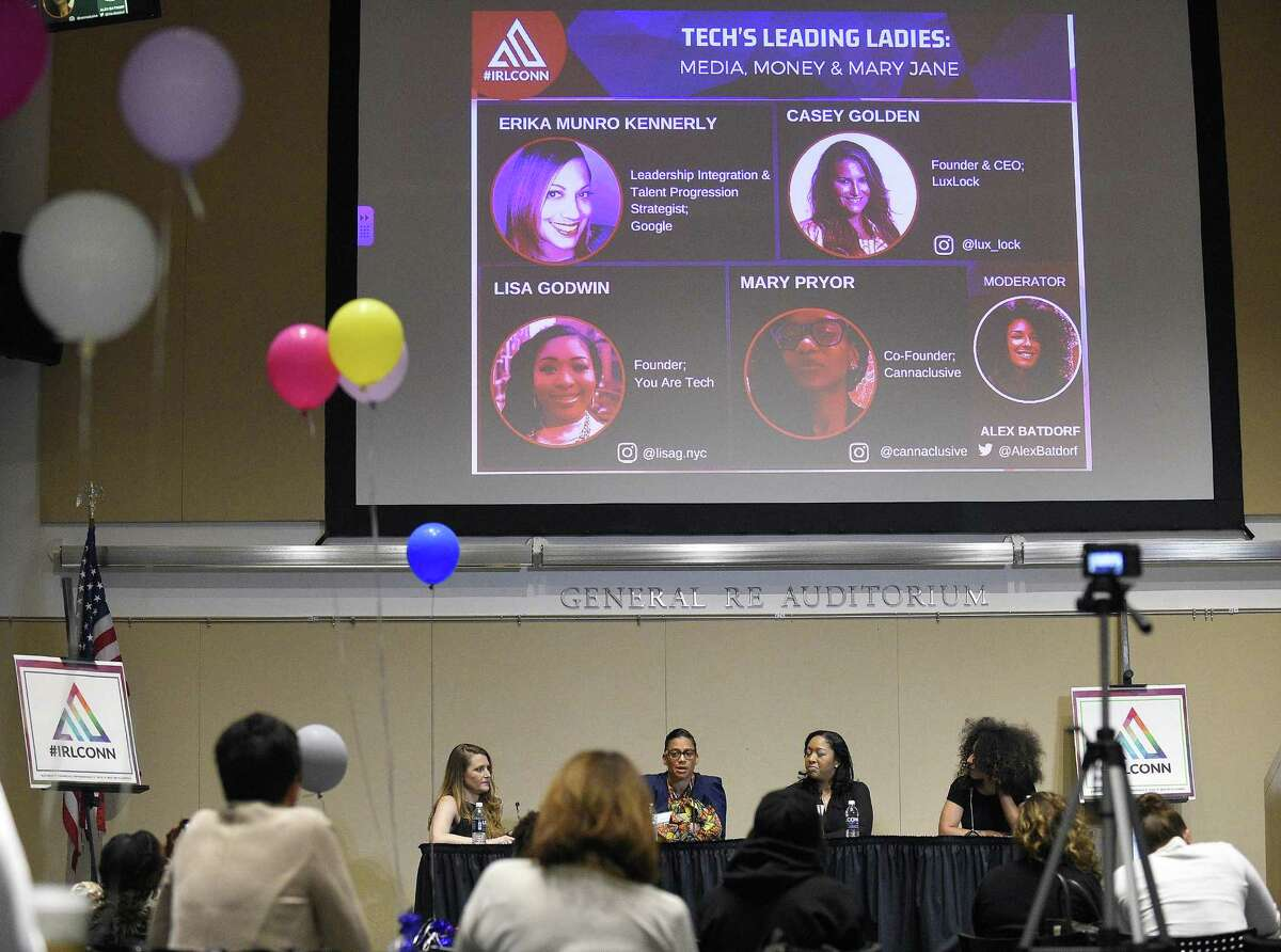 From left, Casey Golden, founder and CEO of Luxlock; Google executive Erika Munro Kennerly; Lisa Godwin, founder of You are Tech; and moderator Alex Batdorf, a business coach and entrepreneur, participate in a panel discussion on women in the technology industry during the IRLConn