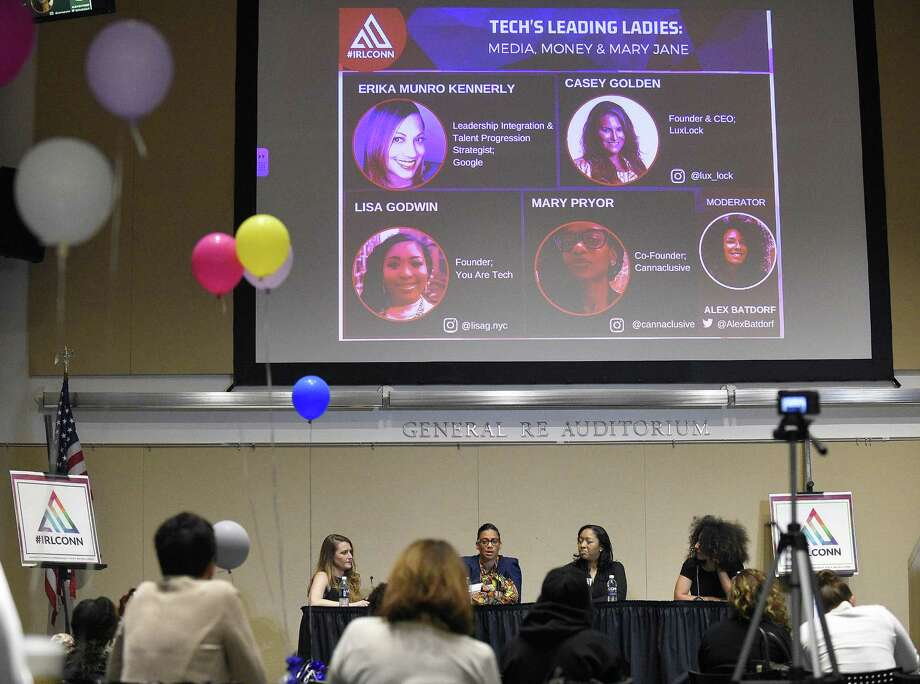"From left, Casey Golden, founder and CEO of Luxlock; Google executive Erika Munro Kennerly; Lisa Godwin, founder of You are Tech; and moderator Alex Batdorf, a business coach and entrepreneur, participate in a panel discussion on women in the technology industry during the IRLConn ""In Real Life"" conference at University of Connecticut-Stamford campus, on May 11, 2018. Photo: Matthew Brown / Hearst Connecticut Media / Stamford Advocate"