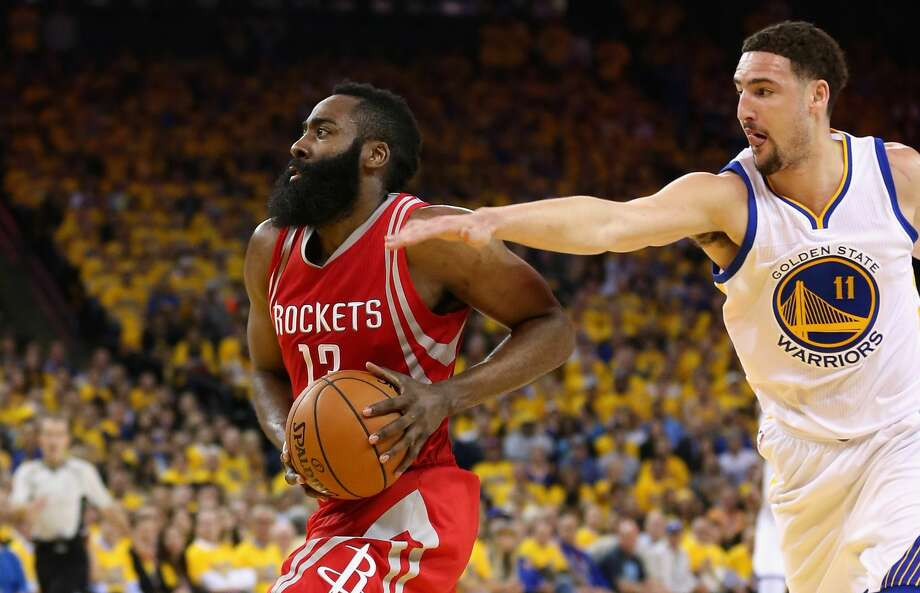 OAKLAND, CA - APRIL 27:  James Harden #13 of the Houston Rockets drives on Klay Thompson #11 of the Golden State Warriors in Game Five of the Western Conference Quarterfinals during the 2016 NBA Playoffs at ORACLE Arena on April 27, 2016 in Oakland, California. NOTE TO USER: User expressly acknowledges and agrees that, by downloading and or using this photograph, user is consenting to the terms and conditions of Getty Images License Agreement.  (Photo by Ezra Shaw/Getty Images) Photo: Ezra Shaw/Getty Images