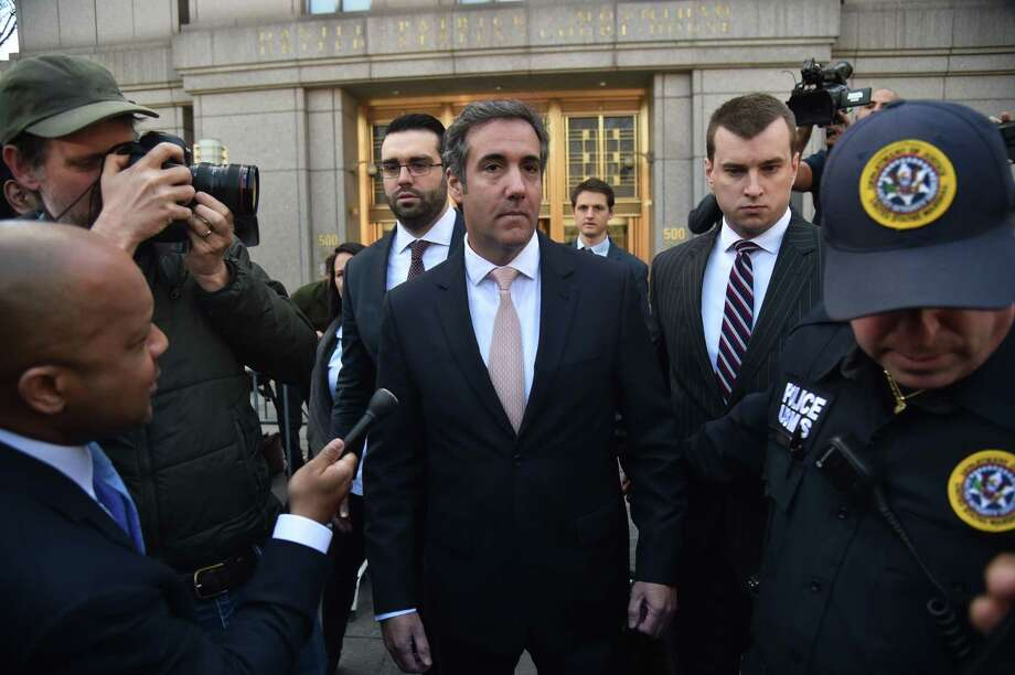 In this file photo taken on April 26, 2018 US President Donald Trump's personal lawyer Michael Cohen(C) leaves the US Courthouse in New York on April 26, 2018.  Photo: HECTOR RETAMAL /AFP /Getty Images / AFP or licensors
