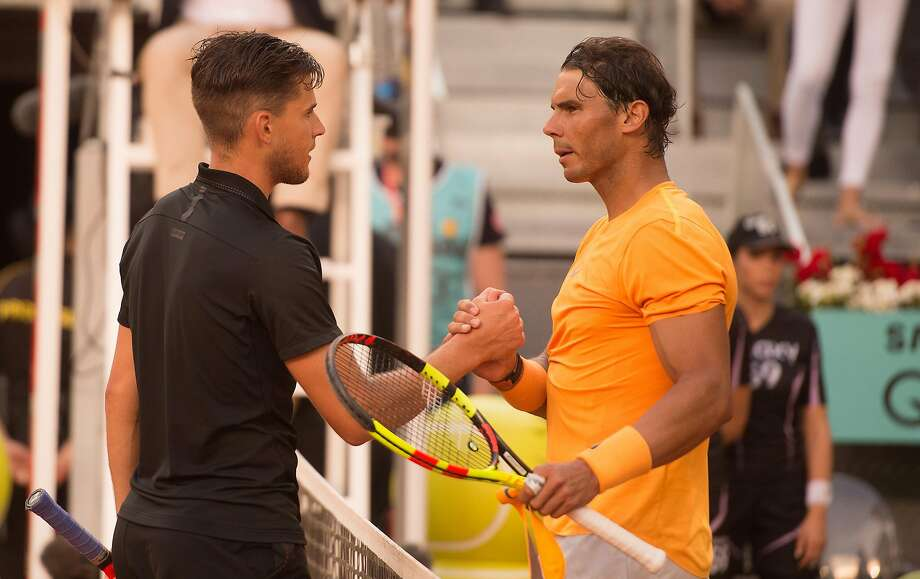 MADRID, SPAIN - MAY 11: Dominic Thiem of Austria shakes hands with Rafael Nadal of Spain after his straight sets victory during their quarterfinal match on day seven of Mutua Madrid Open at the Caja Magica on May 11, 2018 in Madrid, Spain. (Photo by Denis Doyle/Getty Images) Photo: Denis Doyle / Getty Images
