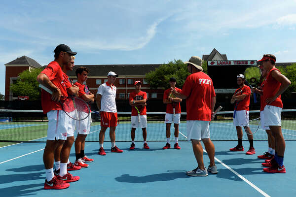 Scott Shankles, center, head coach of Lamar's  men's tennis team, talks with the team as they prepare for the NCAA tournament. The Cardinals will face Texas A&M in the first round.  Photo taken Tuesday 5/8/18 Ryan Pelham/The Enterprise