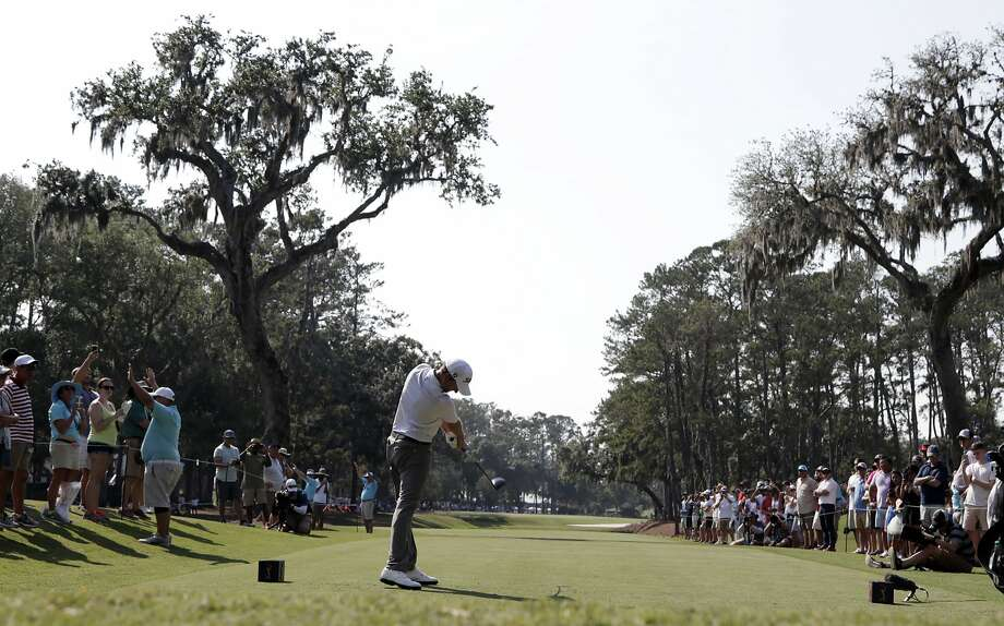 Webb Simpson, hitting from the 15th tee during the second round of The Players Championship, is the seventh play to shoot 63 at TPC Sawgrass. Photo: Lynne Sladky / Associated Press