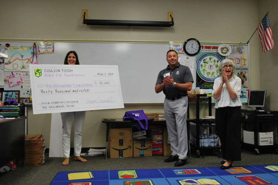 Coulson Tough Elementary Principal Shawn Creswell presented the $30,000 check to Carol Herron, The Program Coordinator for Texas Children's Art & Medicine Program and The Periwinkle Foundation Executive Director Doug Suggitt on Monday. Photo: Dawn Caldwell