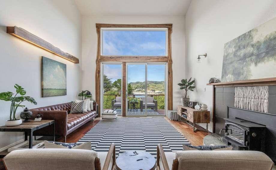 A six-bedroom home listed for $1.8 million is perched in the hills of Pacifica overlooking Pedro Point. Photo: Steve West