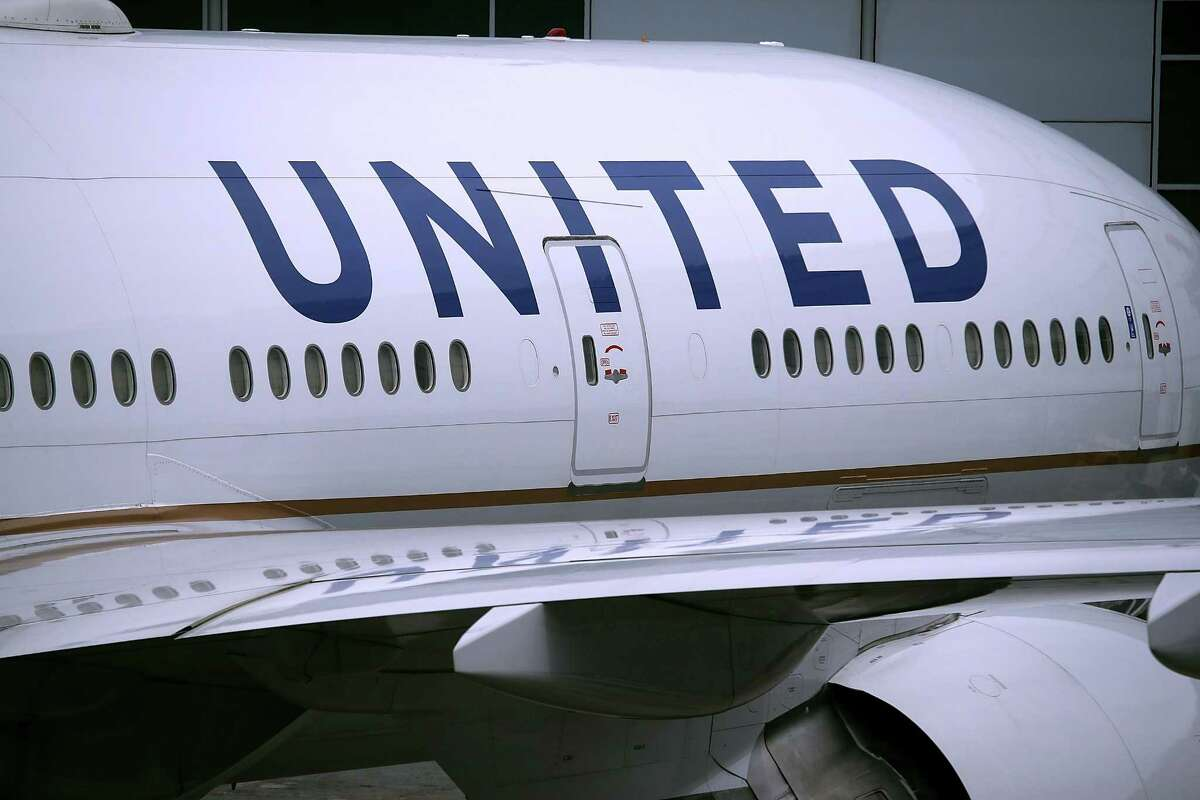 """United Airlines planes sit on the tarmac at San Francisco International Airport on April 18, 2018 in San Francisco, California. A Nigerian passenger sued United Airlines alleging racial discrimination. She said the airline ejected her at George Bush Intercontinental Airport due to her """"pungent"""" odor. (Photo by Justin Sullivan/Getty Images)"""
