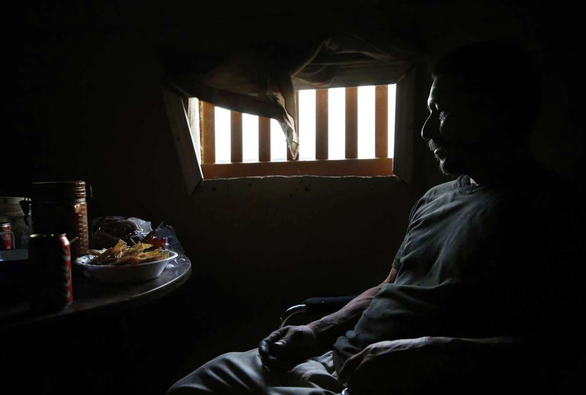 """Mart?'n Hernandez Mena, 50, eats a dinner donated by locals from town in a friend's home in the shantytown situated in a dried up canal on Westlands Water District land Oct. 15, 2015 outside of Mendota, Calif. Mena has lived for a year and a half in the canal bed after he could no longer afford rent in town. Mena has lived in the U.S. for 12 years and has four grown children in Mexico, where he is from. He used to have steady farm work, starting with water melons, cantaloupes, grapes, tomatoes and pomegranate. The last few years he worked in pistachios and almonds and it was five years ago that he last had steady work as an employee. Since then, he says, it has been harder to find work. Mena mostly survives by doing work for others who live in the shantytown, such as building and fixing things for them. Sometimes he finds odd jobs in Mendota working for people in town. """"I keep thinking and hoping of finding ways to get out of this canal. Once I?•m free from that, I can focus on other things.?"""" Mena said in Spanish. ?'All your energy goes to just getting by here."""" Those who live in the encampment and others from Mendota say that there have been a small number of structures in the canal bed for years. But as California entered into the third and fourth years of one of the worst droughts in its modern history, the shantytown bloomed to nearly 30 structures. Mendota has a population of about 11,500 people with more than 40 percent of the population living below the poverty line. Steady work has become more and more difficult to find for community members who depend heavily on the agriculture industry. After months of litigation, Westlands Water District evicted the shantytown residents in November."""